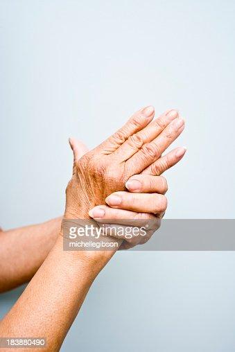 Elderly woman's with arthritis in her hands