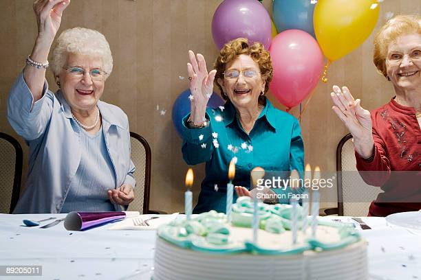 Elderly Women at Birthday Party With Decorations