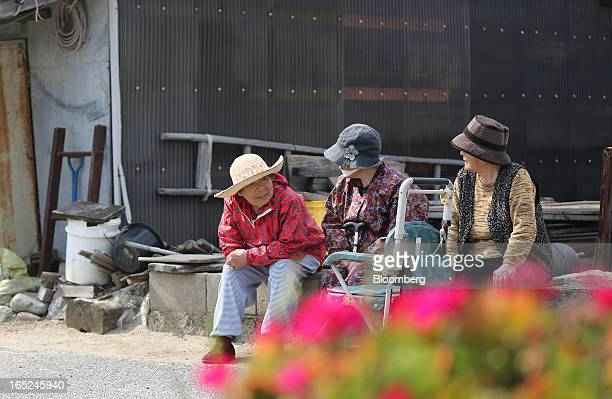 Elderly women chat as they sit by the side of a road on Gogo Island in Matsuyama Ehime Prefecture Japan on Friday March 22 2013 A combination of the...