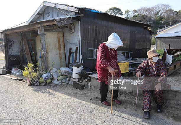 Elderly women gather by the side of a road on Gogo Island in Matsuyama Ehime Prefecture Japan on Friday March 22 2013 A combination of the world's...