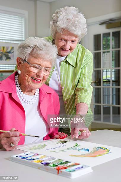 Elderly women painting