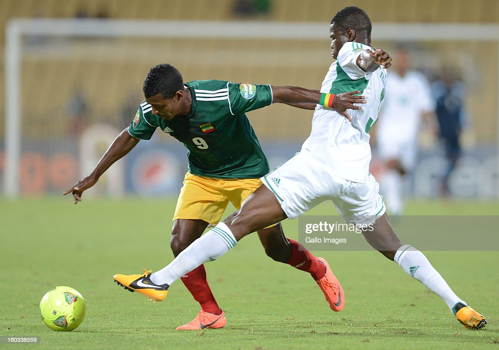 AFRICA - JANUARY 29, Elderson Echiejile of Nigeria (R) challenges Getaneh Kebede during the 2013 African Cup of Nations match between Ethiopia and Nigeria at Royal Bafokeng Stadium on January 29, 2013 in Rustenburg, South Africa.