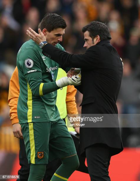 Eldin Jakupovic of Hull City and Marco Silva Manager of Hull City speak following victory during the Premier League match between Hull City and...