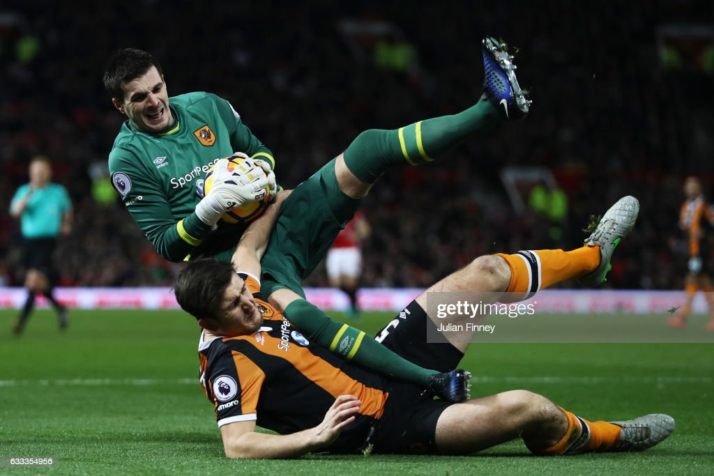 Eldin Jakupovic of Hull City clashes with Harry Maguire of Hull City during the Premier League match between Manchester United and Hull City at Old Trafford on February 1, 2017 in Manchester, England.