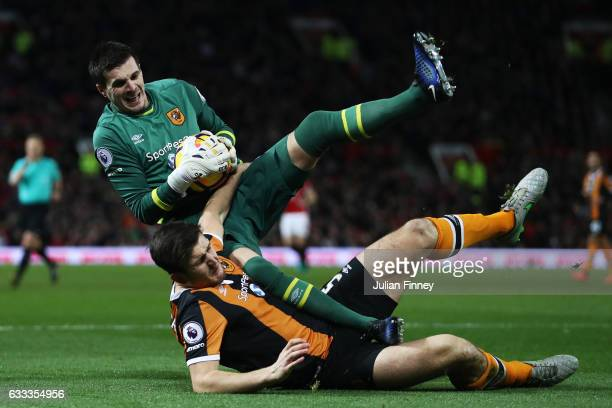 Eldin Jakupovic of Hull City clashes with Harry Maguire of Hull City during the Premier League match between Manchester United and Hull City at Old...