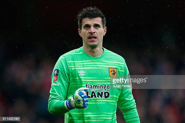 Eldin Jakupovic of Hull City reacts after making a save a free kick by Joel Campbell of Arsenal during the Emirates FA Cup fifth round match between...