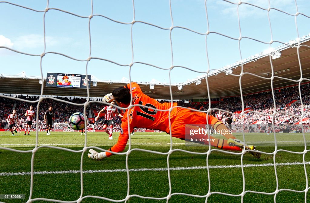 Eldin Jakupovic of Hull City saves a penalty from Dusan Tadic of Southampton during the Premier League match between Southampton and Hull City at St Mary's Stadium on April 29, 2017 in Southampton, England.