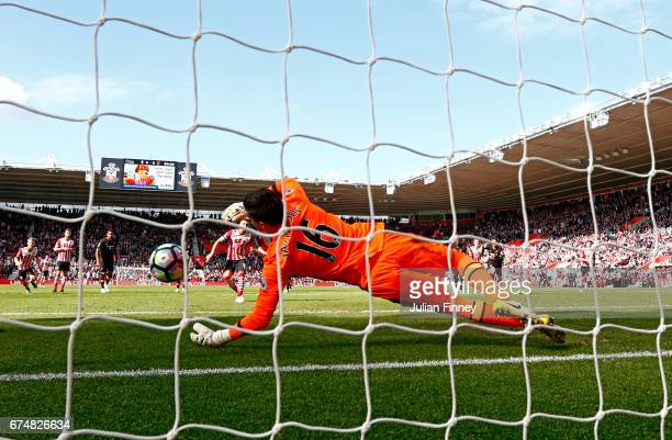 Eldin Jakupovic of Hull City saves a penalty from Dusan Tadic of Southampton during the Premier League match between Southampton and Hull City at St...