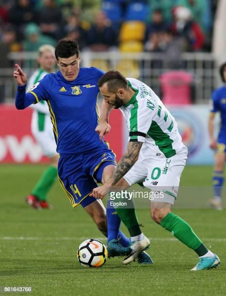 Eldor Shomurodov of FC Rostov RostovonDon is challenged by Fyodor Kudryashov of FC Rubin Kazan during the Russian Premier League match between FC...