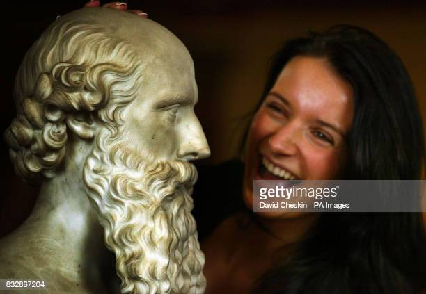 Eleana Rataeva a staff member at Lyon Turnbull in Edinburgh looks at a bust from the collection at Cairness of W H Cassels by Hiram Powers which is...