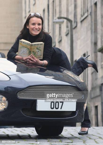 Eleana Ratcheva an employee at Lyon Turnbull auction house Edinburgh holds one of a collection of 007 novels valued at 5250