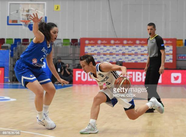 Eleanna Christinaki of Greece vies with France's Celine Dumerc during the FIBA EuroBasket women's Basketball match France v Greece on June 19 2017 in...