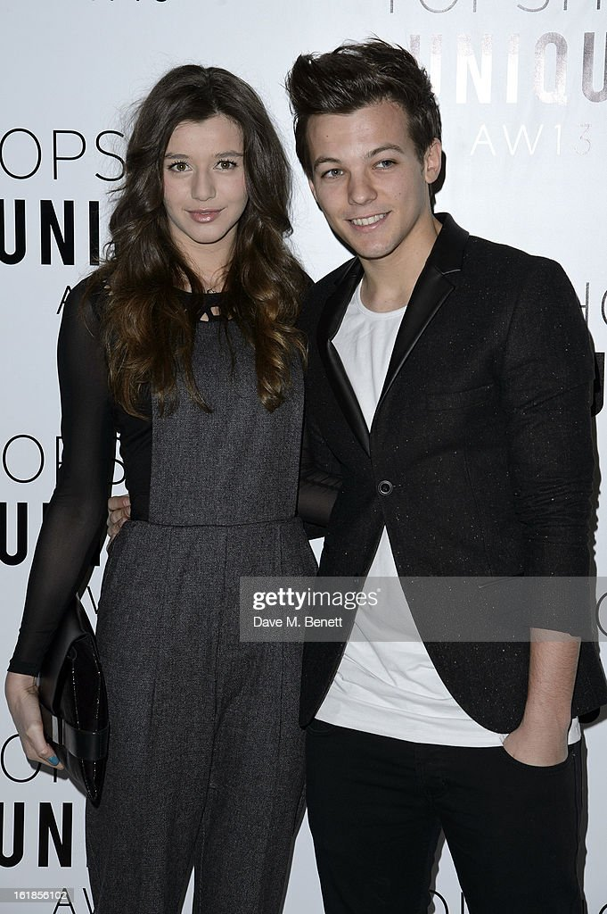 <a gi-track='captionPersonalityLinkClicked' href=/galleries/search?phrase=Eleanor+Calder&family=editorial&specificpeople=9633052 ng-click='$event.stopPropagation()'>Eleanor Calder</a> and <a gi-track='captionPersonalityLinkClicked' href=/galleries/search?phrase=Louis+Tomlinson&family=editorial&specificpeople=7235196 ng-click='$event.stopPropagation()'>Louis Tomlinson</a> of One Direction attends the Topshop Unique Autumn/ Winter 2013 catwalk show at the Topshop Show Space on February 17, 2013 in London, England.