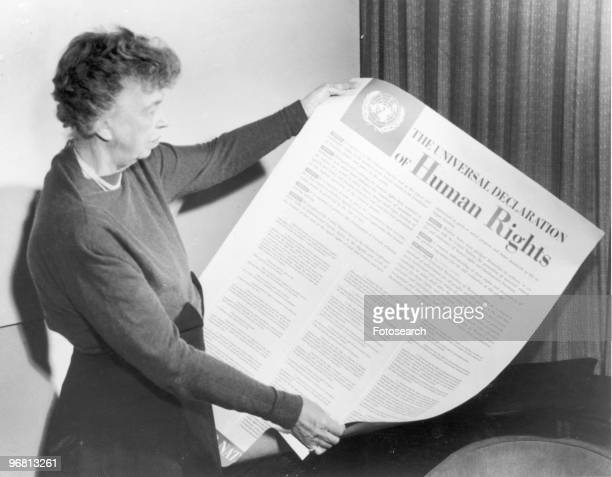 Eleanor Roosevelt holds up a copy of 'THE UNIVERSAL DECLARATION OF HUMAN RIGHTS' circa 1947