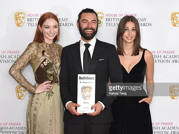 Eleanor Tomlinson Aidan Turner and Heida Reed accepting the Radio Times BAFTA Audience Award for 'Poldark' pose in the winners room at the House Of...