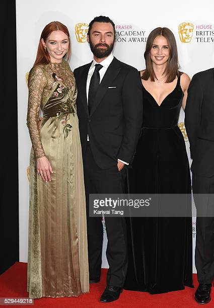 Eleanor Tomlinson Aidan Turner and Heida Reed pose in the winners room at the House Of Fraser British Academy Television Awards 2016 at the Royal...
