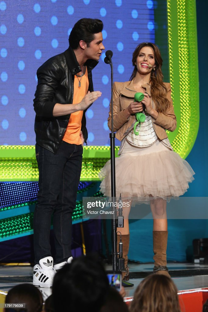 Eleazar Gomez and Claudia Alvarez speak onstage during the Kids Choice Awards Mexico 2013 at Pepsi Center WTC on August 31, 2013 in Mexico City, Mexico.
