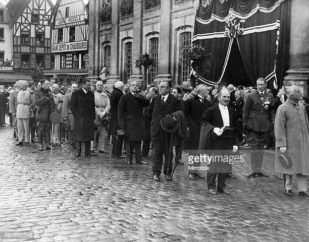 Elebrities including Air Chief Marshall Sir John Salmen line up outside the Beauvais Town Hall in France for the funeral procession of the victims of...