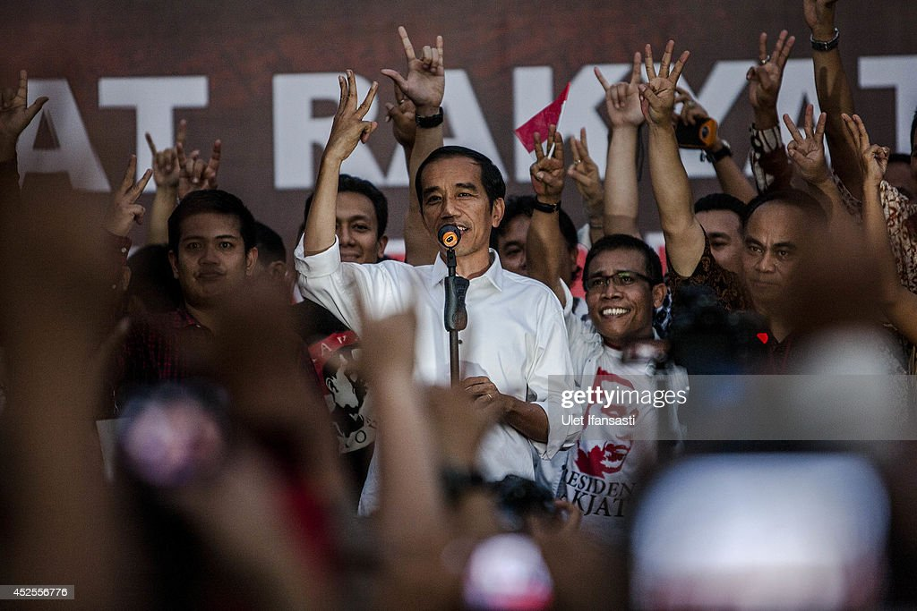 Elected Indonesian President <a gi-track='captionPersonalityLinkClicked' href=/galleries/search?phrase=Joko+Widodo&family=editorial&specificpeople=6657368 ng-click='$event.stopPropagation()'>Joko Widodo</a> delivers a speech to his supporters during victory celebrations on July 23, 2014 in Jakarta, Indonesia. Widodo was declared the winner of the presidential election with 53 percent of the vote over his rival Prabowo Subianto, who withdrew from the contest shortly before the numbers were released, citing fraud.