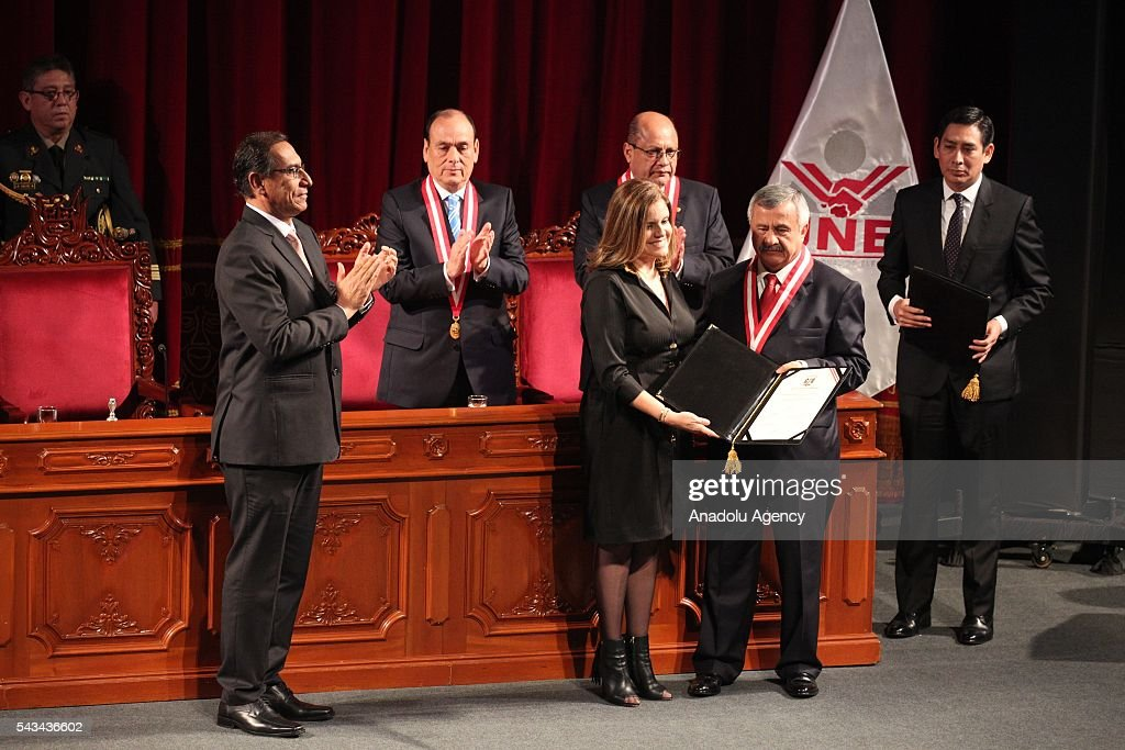 Elected second Vice-President Mercedes Araoz (L) receives her credentials from the president of the National Electoral Jury (JNE), Francisco Tavara, during a ceremony in Lima on June 28, 2016 a month before taking office.