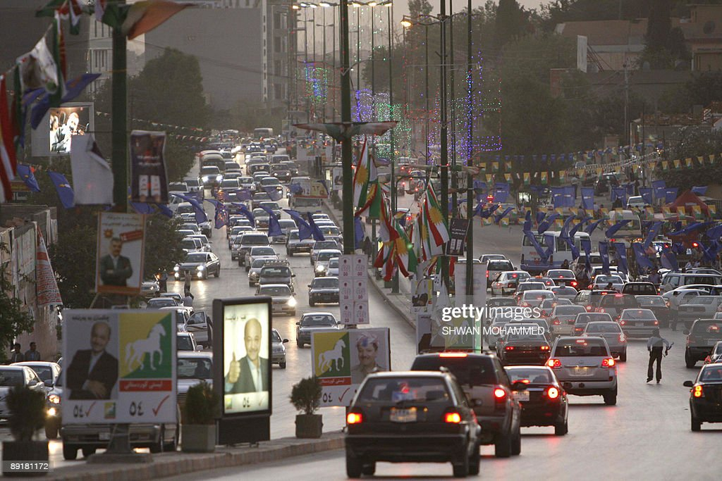 Election billboards adorn the streets of the northern city of Sulaimaniyah in the autonomous Kurdish region some 330 kms from Baghdad on July 21 2009...