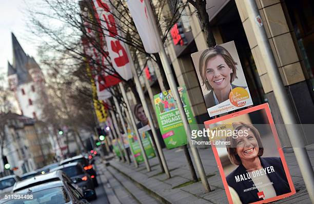 Election campaign billboards featuring lead candidate of the German Christian Democrats Julia Kloeckner as well the prime minister of...