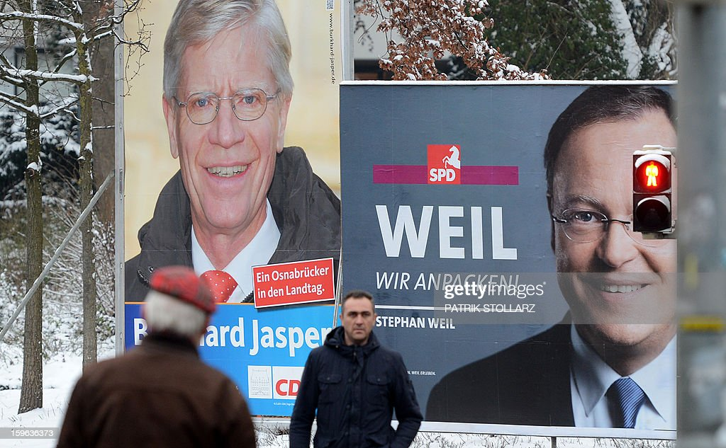 Election campaign billboards featuring Lower Saxony candidates of Christian Democratic Union (CDU) (L) and Social Democratic Party (SPD) (R) are seen on January 16, 2013 in Osnabrueck, Germany. Lower Saxony is holding state elections on January 20 and many analysts see the election as a bellwether for national elections scheduled to take place later this year.