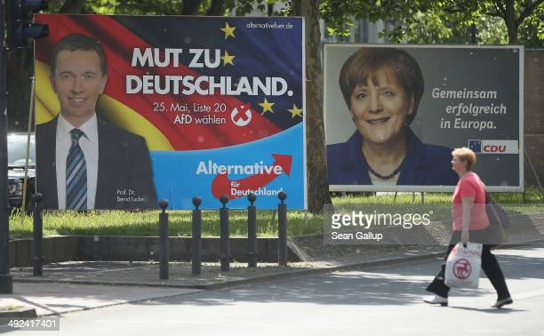 Election campaign billboards for the Eurosceptic Alternative fuer Deutschland showing party head Bernd Lucke and the German Christian Democrats...