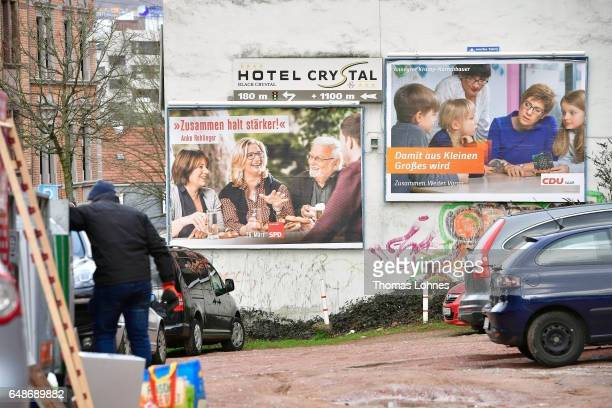 Election campaign billboards for the top candidates Anke Rehlinger and Annegret KampKarrenbauer hang on a haus wall on March 6 2017 in Saarbruecken...