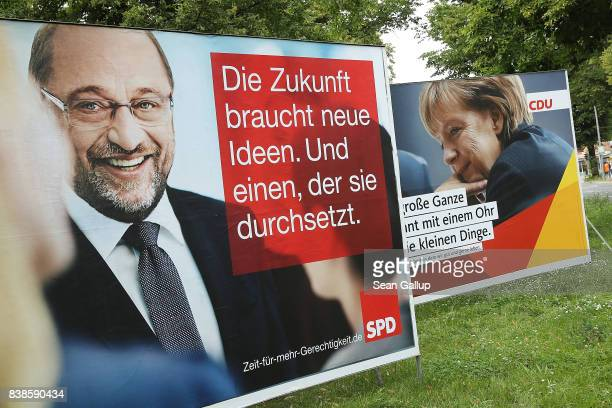 Election campaign billboards that depict German Social Democrat and chancellor candidate Martin Schulz and German Chancellor and Christian Democrat...