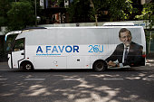 A election campaign bus of Popular Party showing the picture of Mariano Rajoy and reading 'In Favor' is parked outside Popular Party headquarters...