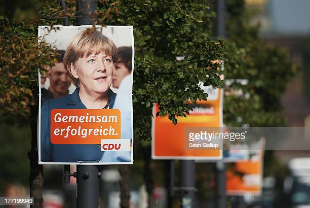 Election campaign posters featuring German Chancellor and Christian Democrat Angela Merkel hang from lampposts on August 22 2013 in Berlin Germany...