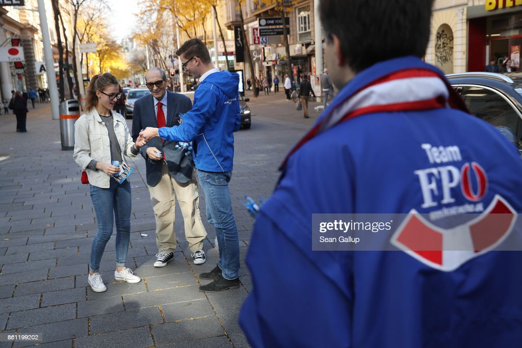 Election campaign workers of the right-wing Austria Freedom Party (FPOe) distribute pamphlets and party mechandise to passers-by on October 14, 2017 in Vienna, Austria. Austria faces parliamentary elections on October 15 and the FPOe, which is running on a 'fairness for Austrians' campaign with strong anti-immigrant, anti-refugee and anti-Islam tones, is currently in third place in polls and could well become a coalition partner in the next Austrian government.