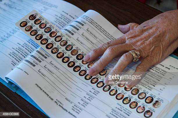 Election Clerk Marilin Malson marks the spot for a voter signature with a presidential ruler November 4 2014 in Hayes Township Franklin County near...