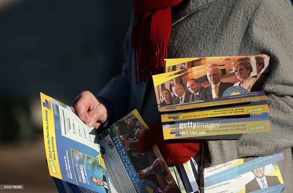 Election flyers are held by a party supporter at Bondi Surf Bathers' Life Saving Club in the electorate of Wentworth on July 2, 2016 in Sydney, Australia. Voters head to the polls today to elect the 45th parliament of Australia.