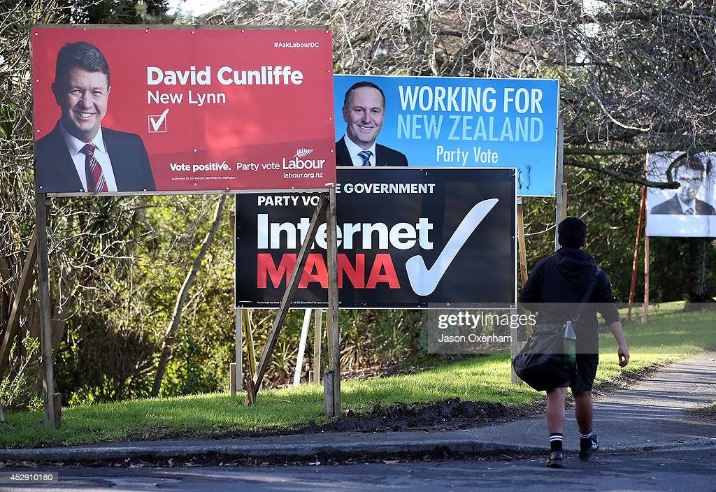 Election hoardings featuring the Labour leader David Cunliffe, the Internet Mana party and National leader John Key in Avondale on July 30, 2014 in Auckland, New Zealand. New Zealand voters will head to the polls on September 20, 2014.