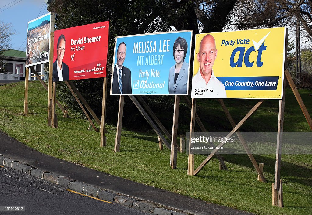 Election hoardings promoting the Green party, the Labour party candidate David Shearer, National party leader John Key, National candidate Melissa Lee and Act party leader Jamie Whyte (R) in Mt Albert on July 30, 2014 in Auckland, New Zealand. New Zealand voters will head to the polls on September 20, 2014.