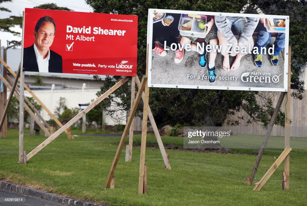 Election hoardings promoting the Labour party candidate David Shearer (L) and the Green party in Mt Albert on July 30, 2014 in Auckland, New Zealand. New Zealand voters will head to the polls on September 20, 2014.