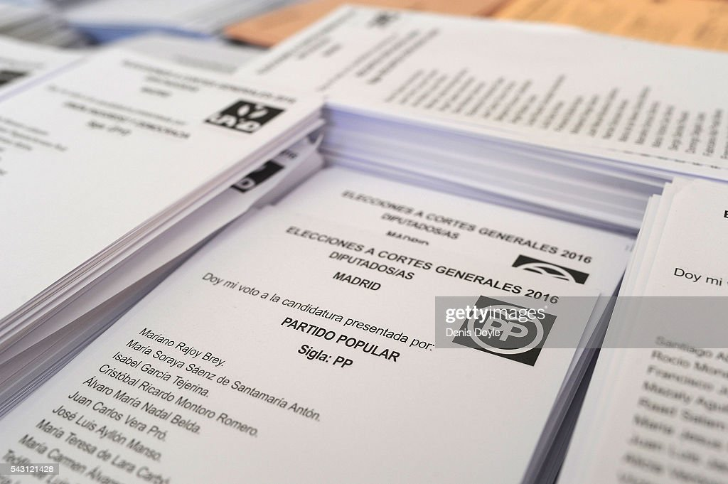 Election lists of the right-wing Popular Party are laid out in a polling booth for the Spanish general election on June 26, 2016 in Madrid, Spain. Spanish voters head back to the polls on June 26 after the last election in December failed to produce a government. Latest opinion polls suggest the Unidos Podemos left-wing alliance could make enough gains to come in second behind the caretaker government of the center-right Popular Party.
