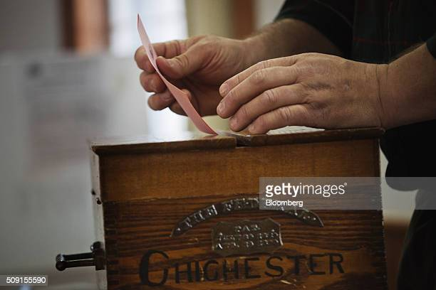 Election Moderator Ewen MacKinnon files a vote in the Chichester ballot box in the firstinthenation New Hampshire presidential primary at the...