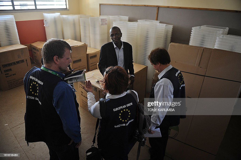 Election observers (back) from the European Union Election Observation Mission (EU EOM) visit a ballot materials warehouse on February 13, 2013 in the Kenyan capital Nairobi, where they observed and had a discussion with poll-officials from the Independent Electoral and Boundaries Commission (IEBC). The March 4 polls are the first since bloody post-election violence five years ago, when what began as political riots quickly turned into deadly ethnic violence which as a result has steeped massive pressure on authorities to conduct a transparent elective process and has seen the east African nation employ modern systems such as biometrics in registration and polling processes. Kenya's foreign minister accused European diplomats on February 11 of trying to influence upcoming presidential elections, where a key candidate faces trial for crimes against humanity. AFP PHOTO / Tony KARUMBA