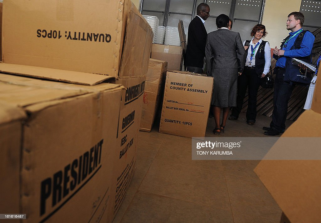 Election observers (R) from the European Union Election Observation Mission (EU EOM) visit a ballot materials warehouse on February 13, 2013 in the Kenyan capital Nairobi, where they observed and had a discussion with poll-officials from the Independent Electoral and Boundaries Commission (IEBC). The March 4 polls are the first since bloody post-election violence five years ago, when what began as political riots quickly turned into deadly ethnic violence which as a result has steeped massive pressure on authorities to conduct a transparent elective process and has seen the east African nation employ modern systems such as biometrics in registration and polling processes. Kenya's foreign minister accused European diplomats on February 11 of trying to influence upcoming presidential elections, where a key candidate faces trial for crimes against humanity. AFP PHOTO / Tony KARUMBA
