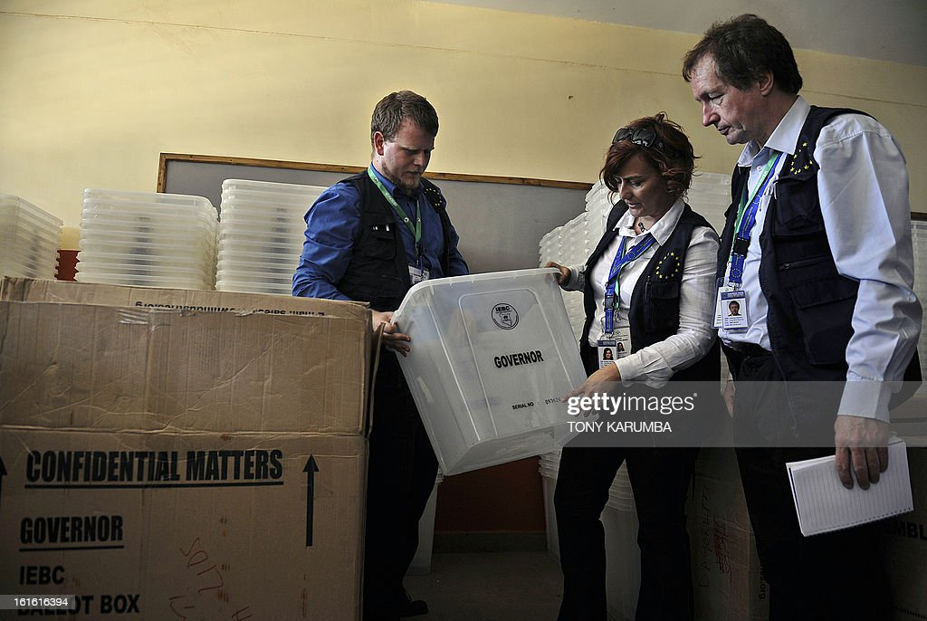 Election observers from the European Union Election Observation Mission (EU EOM) check ballot materials in a warehouse on February 13, 2013 in the Kenyan capital Nairobi, where they observed and had a discussion with poll-officials from the Independent Electoral and Boundaries Commission (IEBC). The March 4 polls are the first since bloody post-election violence five years ago, when what began as political riots quickly turned into deadly ethnic violence which as a result has steeped massive pressure on authorities to conduct a transparent elective process and has seen the east African nation employ modern systems such as biometrics in registration and polling processes. Kenya's foreign minister accused European diplomats on February 11 of trying to influence upcoming presidential elections, where a key candidate faces trial for crimes against humanity. AFP PHOTO / Tony KARUMBA