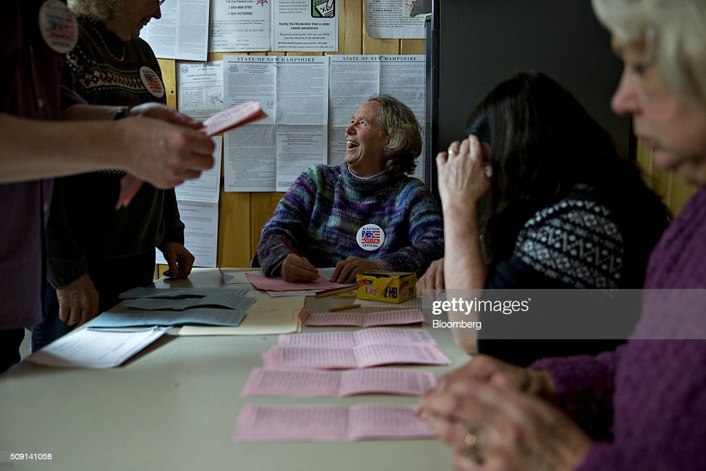 Election official Nancy Ritger laughs as she tallies votes at the town hall polling site during the New Hampshire presidential primary election in Harts Location, New Hampshire, U.S., on Tuesday, Feb. 9, 2016. According to the New Hampshire Secretary of State's office, the state has 383,834 voters who haven't declared a party affiliation, compared to 260,896 registered Republicans and 229,202 Democrats. Photographer: Andrew Harrer/Bloomberg via Getty Images