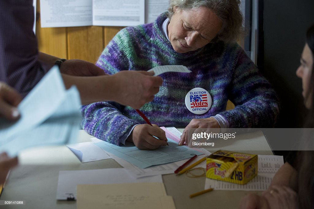 Election official Nancy Ritger tallies votes at the town hall polling site during the New Hampshire presidential primary election in Harts Location, New Hampshire, U.S., on Tuesday, Feb. 9, 2016. According to the New Hampshire Secretary of State's office, the state has 383,834 voters who haven't declared a party affiliation, compared to 260,896 registered Republicans and 229,202 Democrats. Photographer: Andrew Harrer/Bloomberg via Getty Images