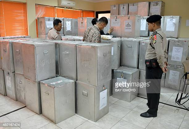 Election officials and police inspect ballot boxes in Jakarta on July 15 in preparation for national level tabulation Indonesia's president urged the...