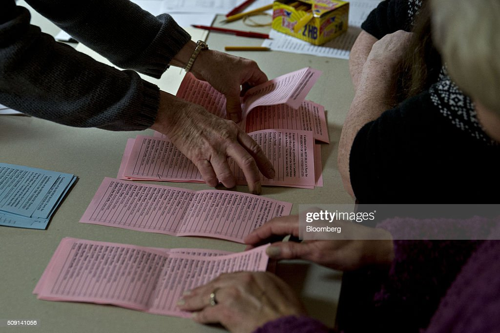 Election officials arrange Republican ballots while counting votes at the town hall polling site during the New Hampshire presidential primary election in Harts Location, New Hampshire, U.S., on Tuesday, Feb. 9, 2016. According to the New Hampshire Secretary of State's office, the state has 383,834 voters who haven't declared a party affiliation, compared to 260,896 registered Republicans and 229,202 Democrats. Photographer: Andrew Harrer/Bloomberg via Getty Images