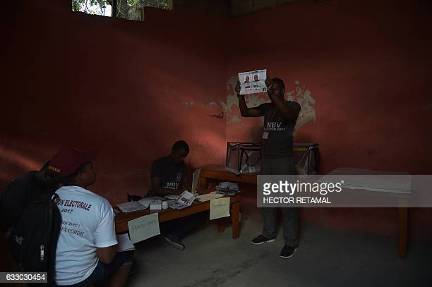 TOPSHOT Election officials count ballots at a polling station during the local and legislative elections in the Roger Ladoceur School in the commune...