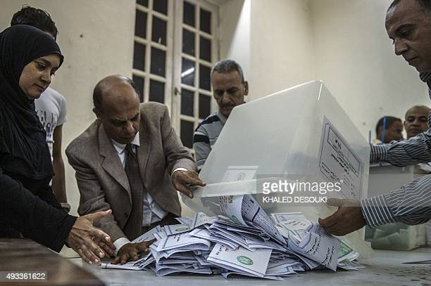 Election officials count ballots at the end of the first round of voting for Egypt's parliamentary election in Giza Cairo on October 19 2015 The...