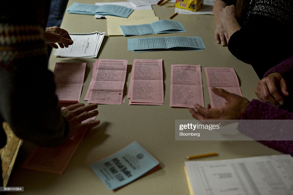 Election officials count votes from ballots at the town hall polling site during the New Hampshire presidential primary election in Harts Location, New Hampshire, U.S., on Tuesday, Feb. 9, 2016. According to the New Hampshire Secretary of State's office, the state has 383,834 voters who haven't declared a party affiliation, compared to 260,896 registered Republicans and 229,202 Democrats. Photographer: Andrew Harrer/Bloomberg via Getty Images